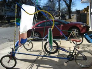 The Big Dam Bike Completed with banner and Mardi Gras Decorations.