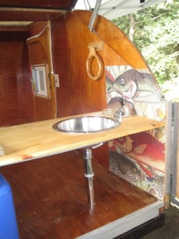 The remodeled teardrop with more art, sink, and countertop.