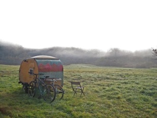 Tiny trailer in a landscape.